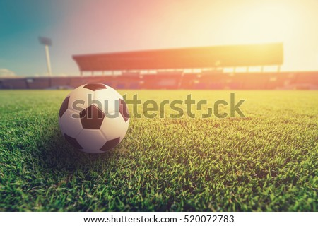Soccer ball on grass in soccer stadium. soccer ball on sunset vintage tone. Baeutiful soccer ball photo.