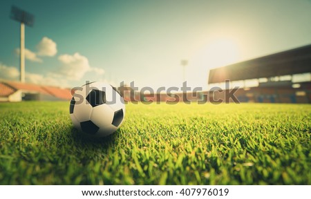 Soccer ball on grass in soccer stadium. soccer football. soccer sport world class. soccer ball on field concept. Soccer ball on vintage tone. soccer ball in soccer stadium on sunset. soccer field.