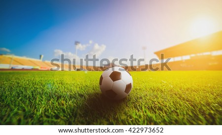 Soccer ball on grass in soccer stadium. soccer football. soccer sport world class. soccer ball on field concept. Soccer ball in the middle image. soccer ball in soccer stadium on sunset. soccer field.