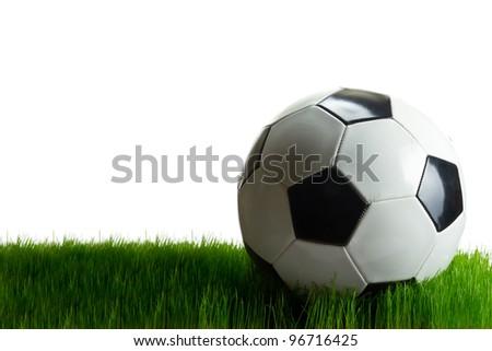 Soccer ball on grass over white background
