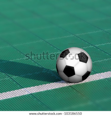 Soccer ball on special outdoor surface field.