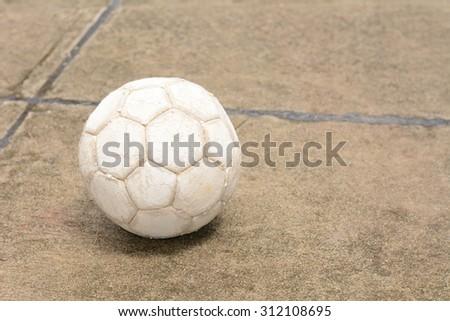 Soccer ball on the cement floor