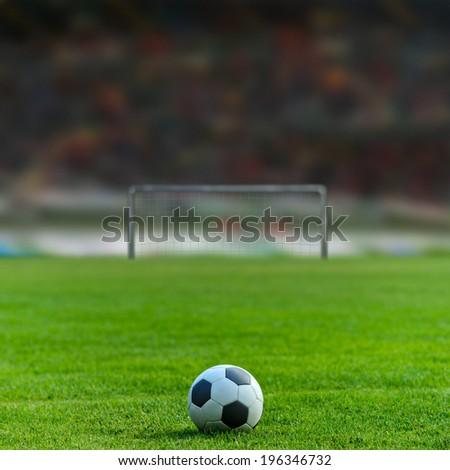 Soccer ball on the field of stadium #196346732