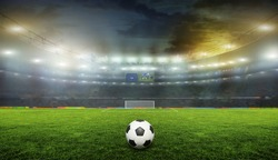 Soccer ball on the field of stadium with light .