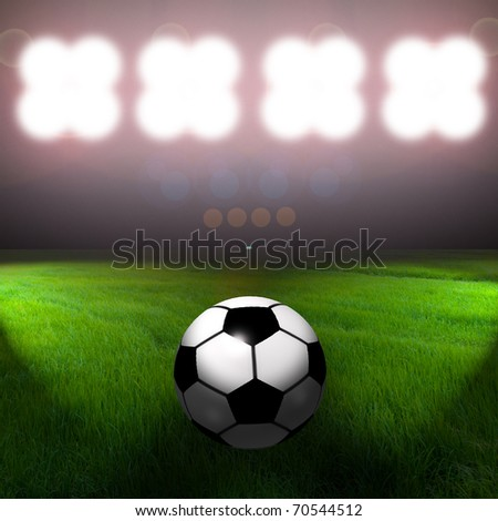 Soccer ball on the field of stadium with spotlight