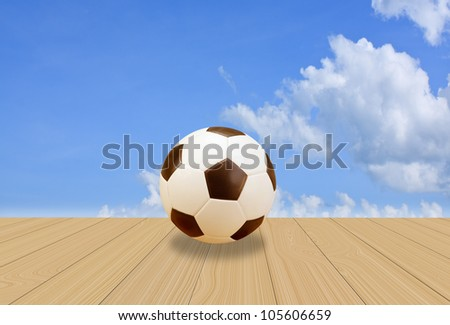 Soccer Ball on wood floor with a blue sky background