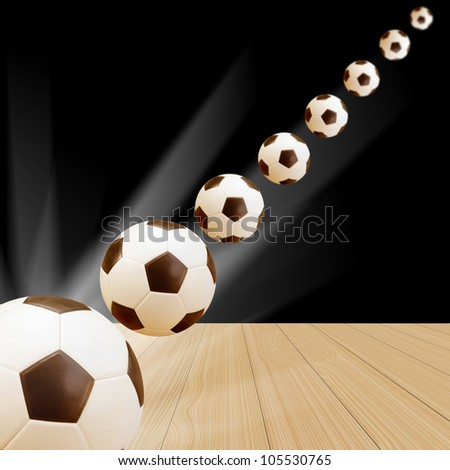 Soccer Ball on wood floor with abstract black and light background