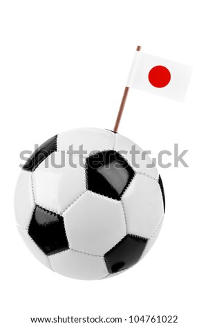 Soccer ball or football decorated with a small national flag of Japan  on a tooth stick