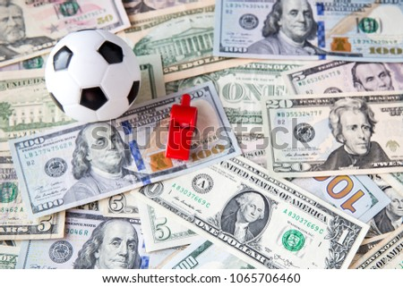 soccer ball over a lot of money. corruption football game. Betting and gambling concept. wold cup 2018. European cup . UEFA Champions League. premier league. bundesliga. la liga. calcio serie a. #1065706460