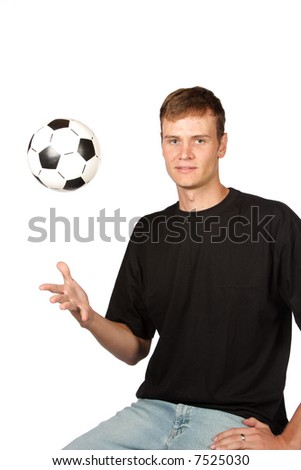 Soccer ball thrown into the air wit one hand