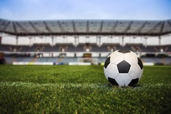 Soccer ball with stadium on the background.