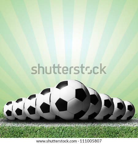 Soccer balls with green rays background.