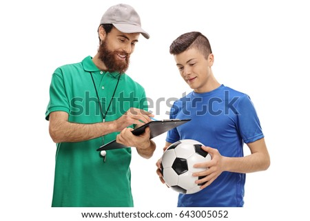 soccer coach advising a teenage ...