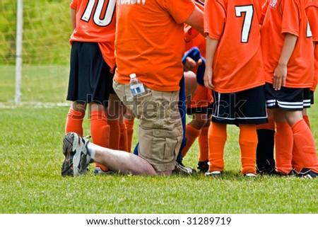 soccer coach with team
