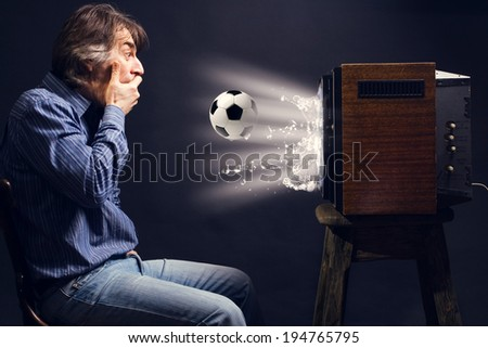 soccer fan watching football on ...