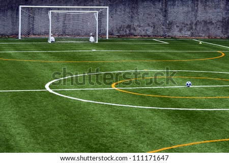 soccer field with ball at the center of the field