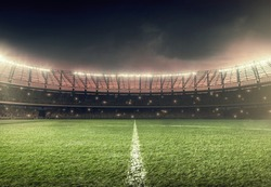 soccer field with illumination, green grass and night sky