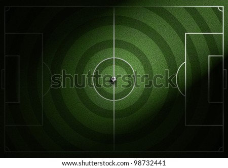 soccer field with soccer ball on grass