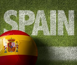 Soccer field with the text: Spain
