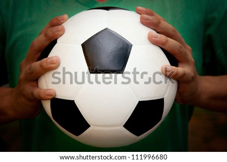 soccer football and holding hand