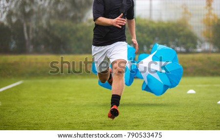 Soccer Football Endurance Training. Speed or Sprint Testing with Parachute. Professional Soccer Strength Test