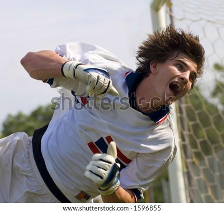 Soccer Football Goalie making diving save - stock photo