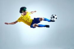 soccer football kick striker scoring goal with accurate shot for brazil team world cup