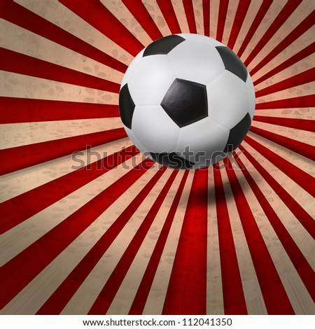 soccer football on colorful ray background