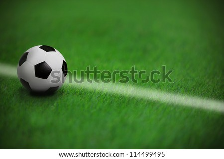 soccer football on green grass in stadium  with white line