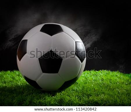 soccer football on green grass studio light
