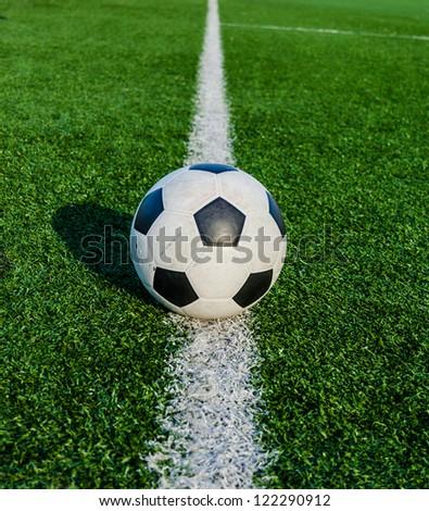 Soccer Football on line of Soccer field. - stock photo