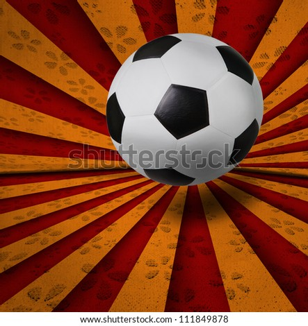 soccer football on red yellow ray background