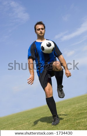 Soccer - Football Player Juggling in a blue and Black Uniform