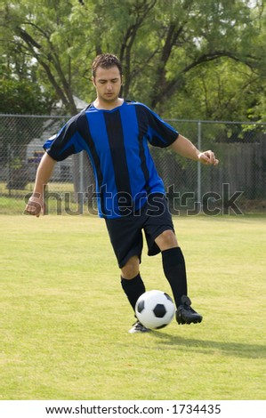 Soccer - Football Player Juggling in blue and black uniform