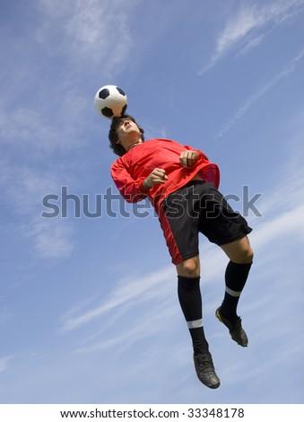 Soccer - Football Player making header
