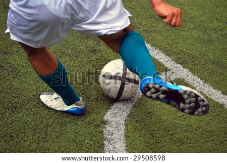 Soccer. Football. Soccer player about to give a kick to the ball