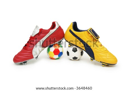 Soccer footwear and color footballs isolated on white