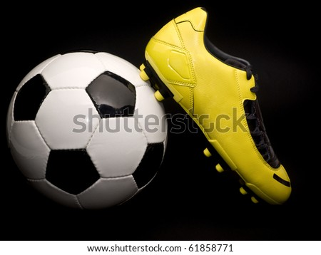 Soccer footwear on  the ball