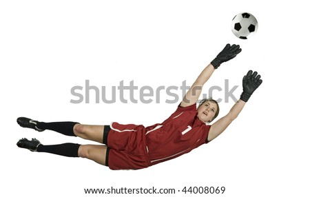 Soccer Goalie leaps for the ball to block