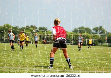 Soccer Goalie Readies for Attack Foto stock ©
