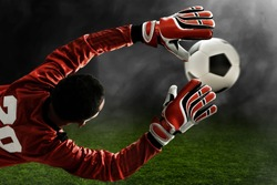 Soccer goalkeeper catches the ball