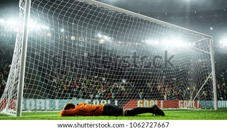Soccer goalkeeper in action on the soccer stadium. He wear unbranded sports clothes. Stadium and crowd made in 3D. #1062727667