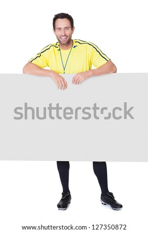 Soccer judge presenting empty banner. Isolated on white background