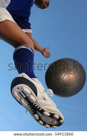 soccer,kick,ball,play,player,game,shoe,sport,sock,fun,cleats,football,blue,white,caucasian,movement,arms,balanced,green,grass