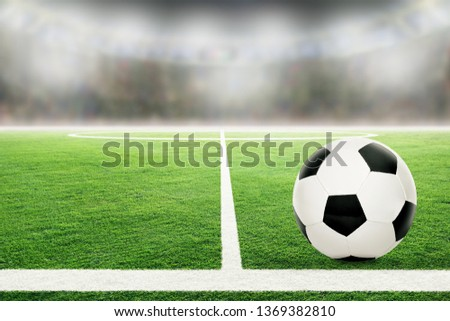 Soccer on football stadium field with blurred crowd background and copy space. #1369382810