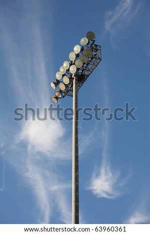 Soccer or Baseball Floodlights against a blue sky with strange cirrus cloud formations