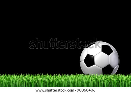 Soccer or European football team sport concept with a leather ball sitting on grass ready for a kick on a black night sky as a sporting icon of fun and physical play with sporting equipment.