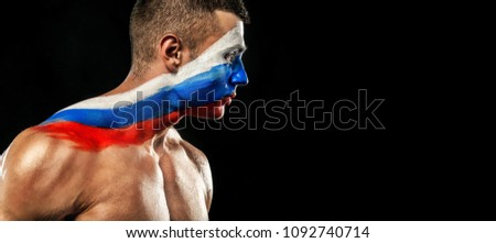 Soccer or football fan with bodyart on face - flag of Russia 2018, on stadium. #1092740714
