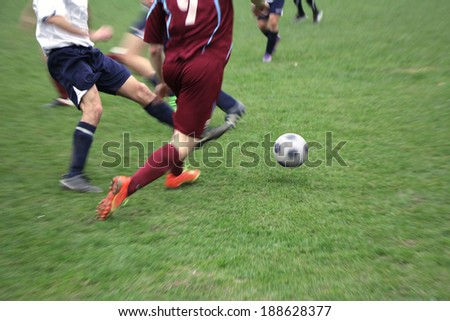 Soccer or football players in action on the field  - stock photo