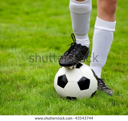 Soccer player and soccerball on the field